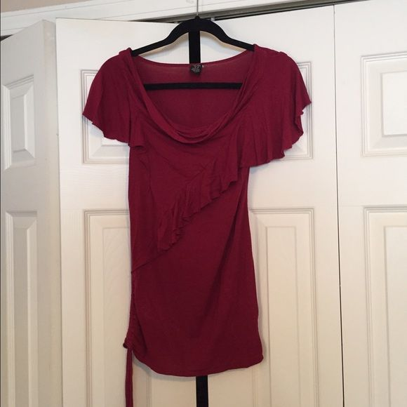 Flowy top Burgundy top. Has string that tightens and can tie in a bow along bottom. Bought at nordstroms juniors department Tops Blouses