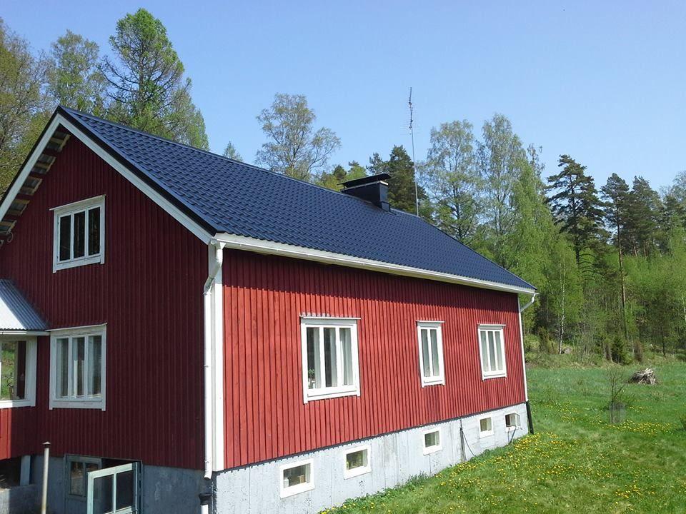 Suuren maatilan asuinrakennuksen kattoremontti