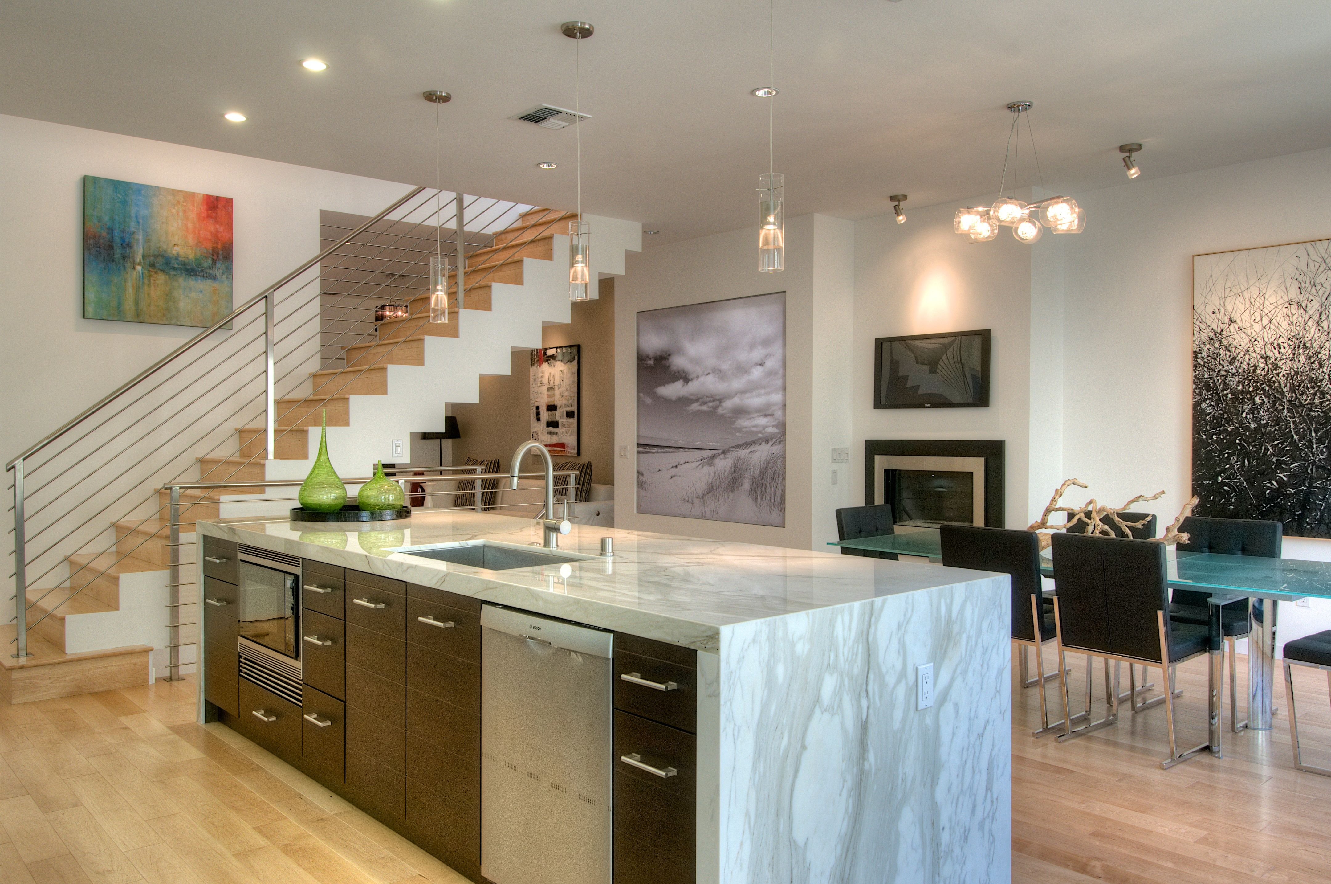 Open floor plan kitchen with floating staircase.   Open ...