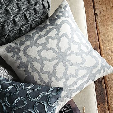 this pillow would go perfectly with the bedding we registered for :)