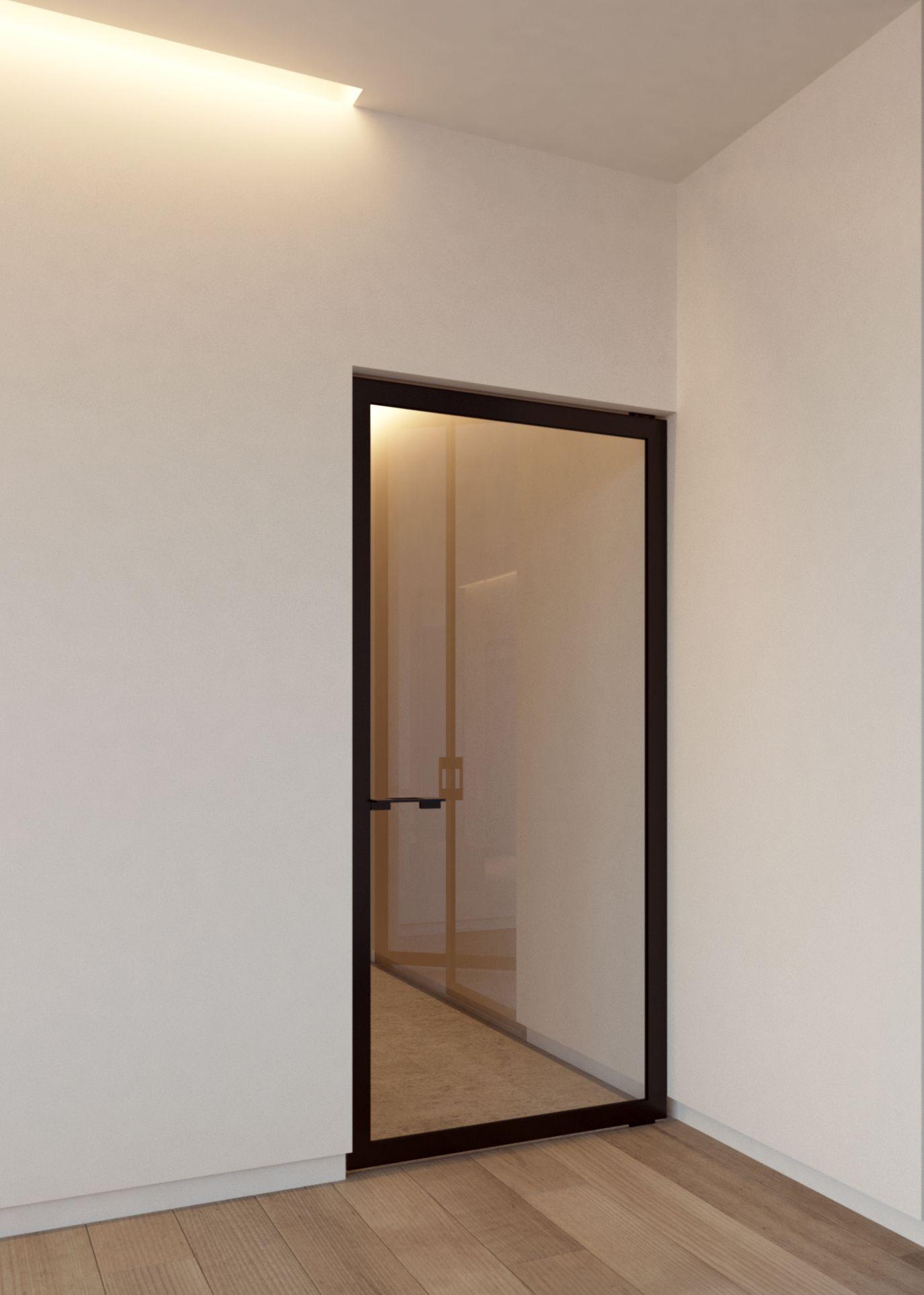 Steel Look Pivot Door With Custom Made Black Anodized