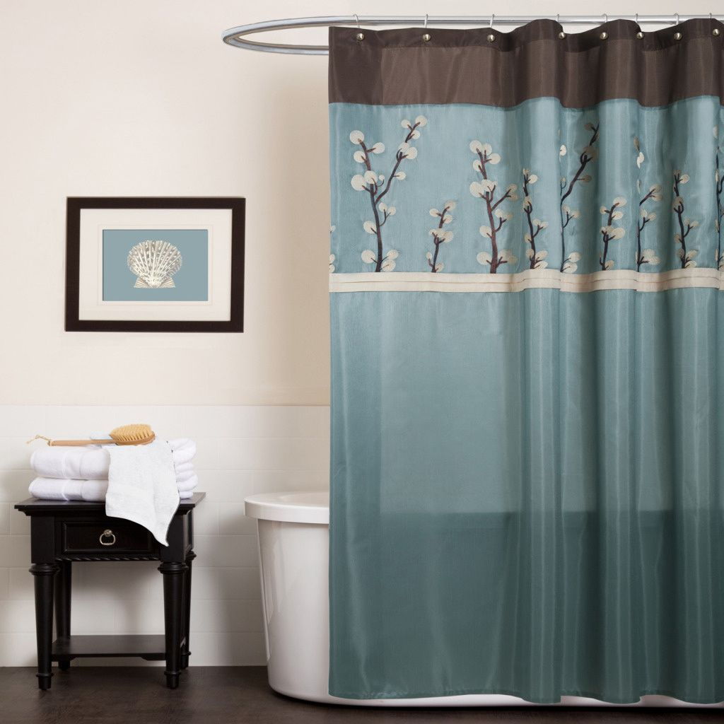 Elegant floral embroidery highlights this lovely shower curtain from
