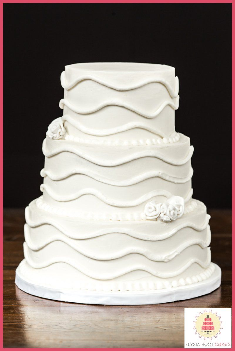 3 tier wedding cake with piped wavy line accents and fondant ribbon ...
