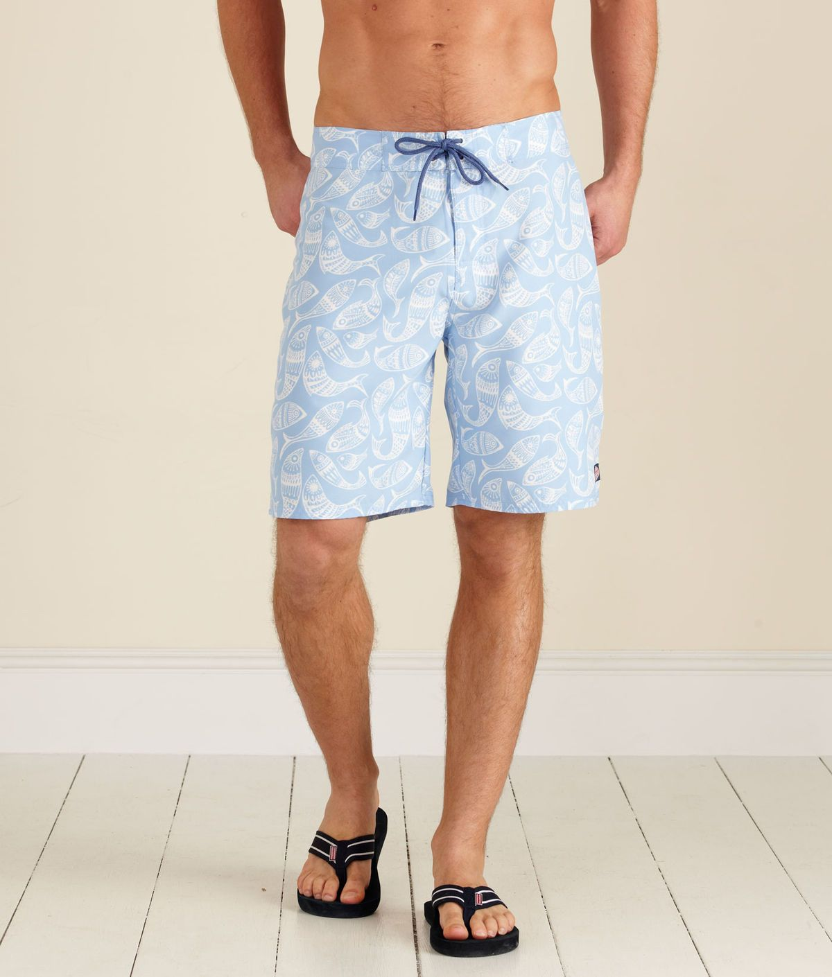 51e0d428c8 board shorts. not too long, not too loose. NO elastic waistband, NO liner,  velcro fly, and lace up draw cord on the OUTSIDE.