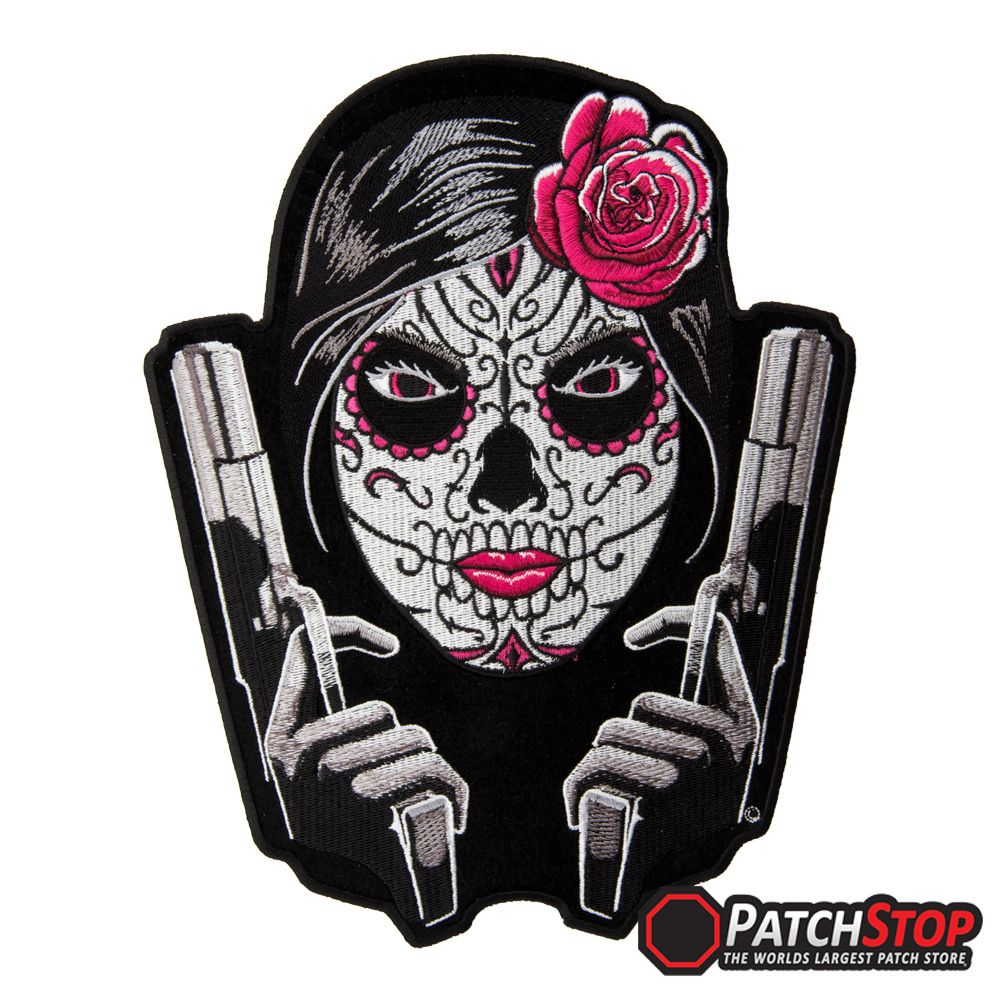 """The Day Of The Dead Girl Twin Guns patch is available in 2 sizes:  Small patch measures 4.25"""" W x 5.25"""" H (10.8cm x 13.3cm)  Large patch measures 8"""" W x 10.25"""" H (20.3cm x 26cm)"""