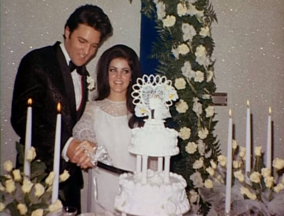 Monday, 29 May 1967: Elvis and Priscilla Presley dress in their wedding clothes and have a second wedding reception in the trophy room at Graceland in Memphis, TN to accommodate family and friends who were not present at their wedding at the Aladdin Hotel in Las Vegas, NV on May 1st, 1967.