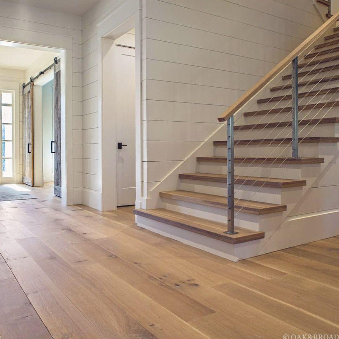 White oak flooring + shiplap + barn doors + cable railing
