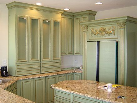 Light Green Antique Kitchen Cabinets In Combination With Natural Stone  Countertops
