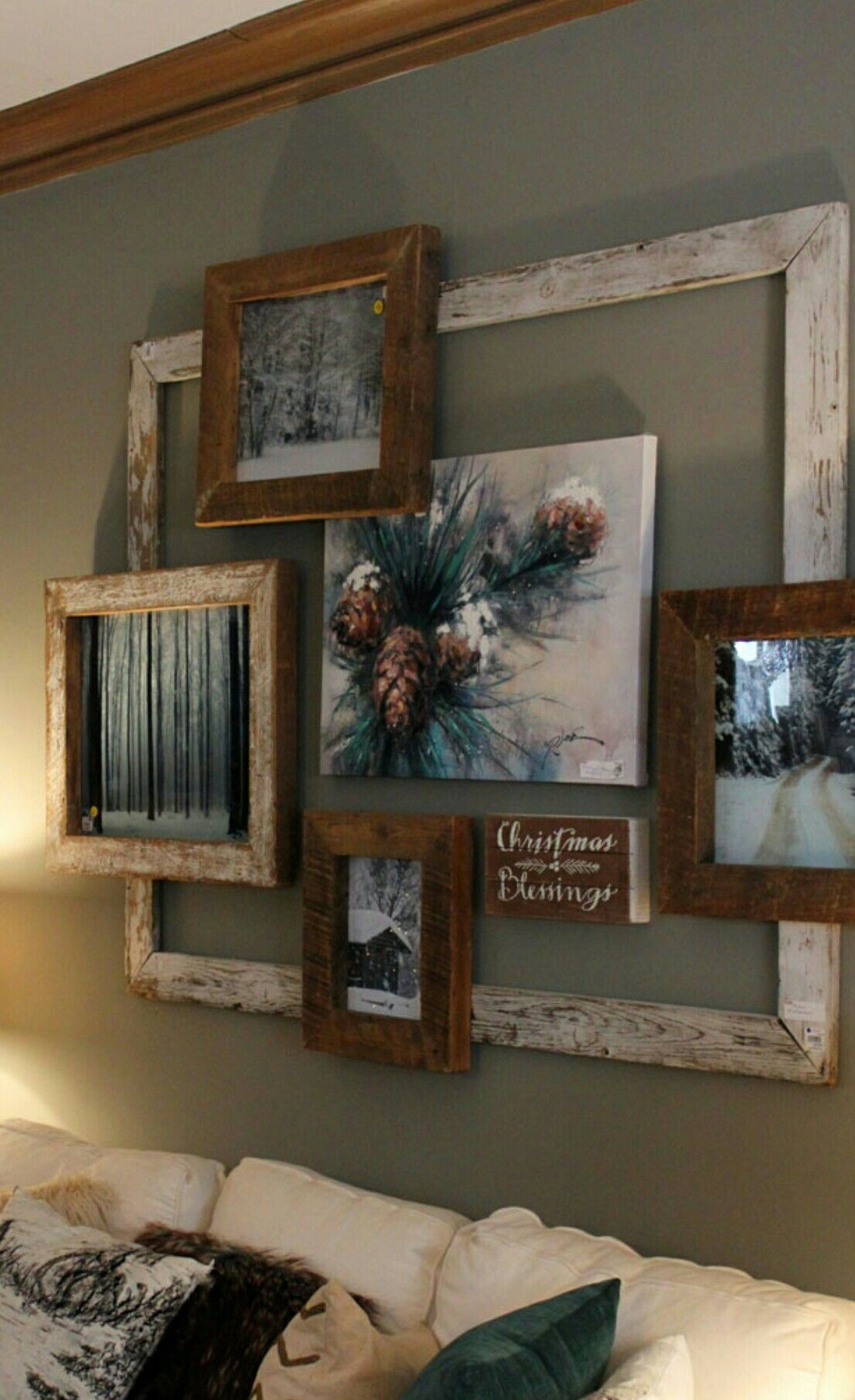Collage of old frames makes a rustic u eye catching focal point in