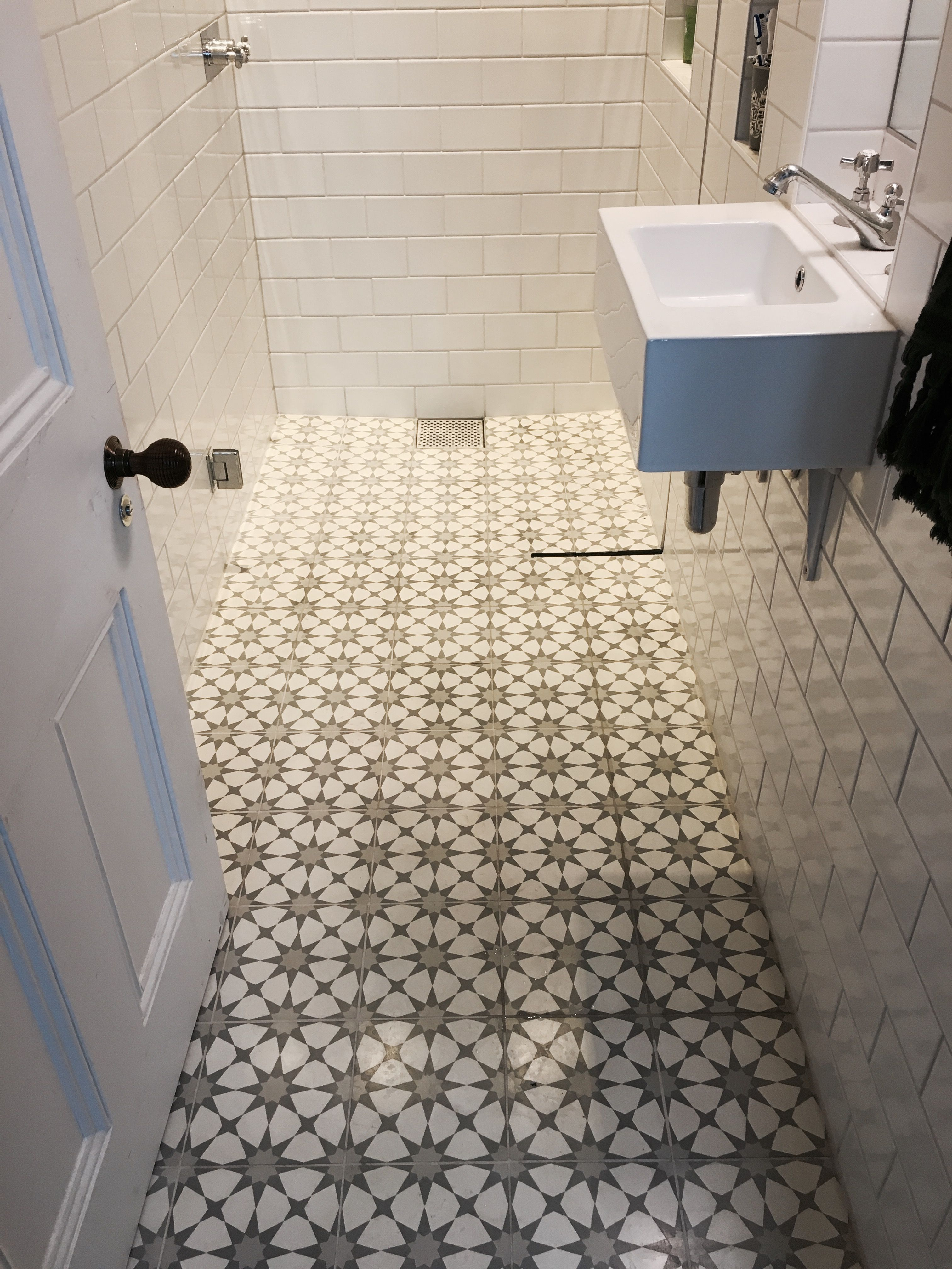 Narrow wetroom shower with encaustic cement floor tiles, crackle ...