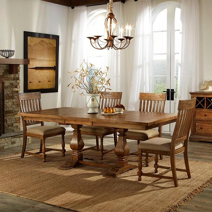 The Nebraska Dining Room is a transitional-style collection that can seat up to six guests. Each piece is constructed from poplar wood and Asian solid wood veneers and finished in a warm weather stain that makes the entire collection more inviting.