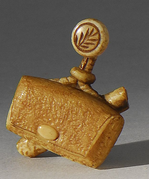 Lot 203: IVORY NETSUKE By Yoshikazu. In the form of a tobacco pouch with manju and pipe holder. Signed. - Eldred's | Invaluable