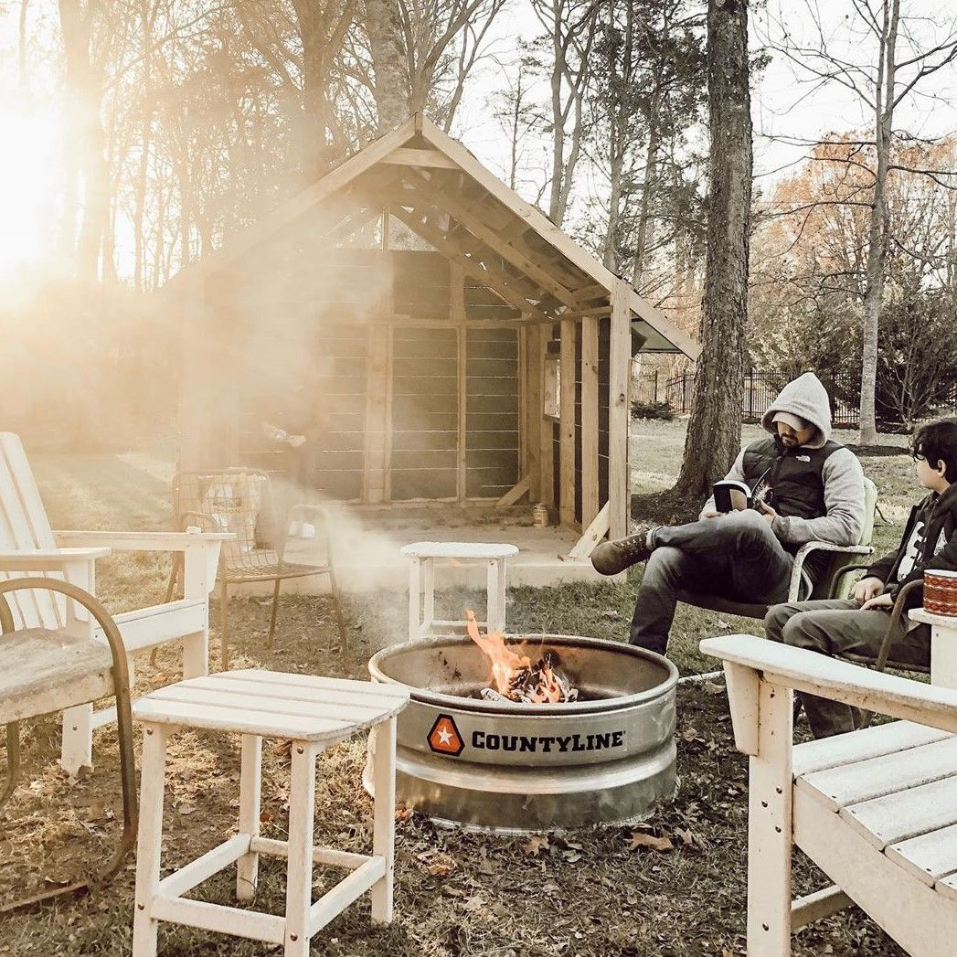 So Cozy Chicken Coop Countyline Fire Pit Ring Some Adirondack Chairs Perfect Backyard Beautiful Backyards Backyard Fire Pit Ring