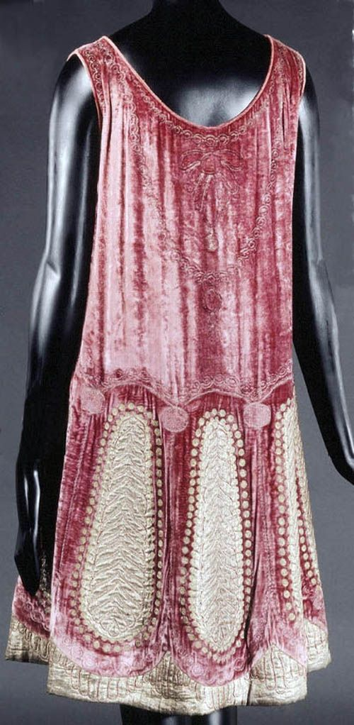 Evening dress, Poiret, ca. 1922-24. Dusty pink panné velvet embroidered in red silk, gold lamé, and metallic chain stitch. Lined in unbleached silk muslin, with padding at hem. Musée Galliera, Musée de la Mode de la Ville de Paris