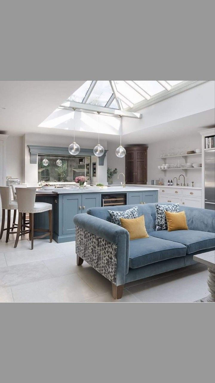 Open concept kitchen and living room with blue island and blue ...