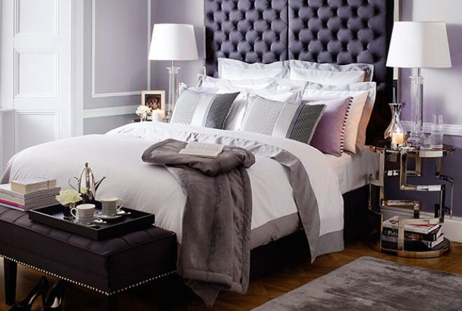 Buttoned headboard sets off grey, black and white bedroom scheme
