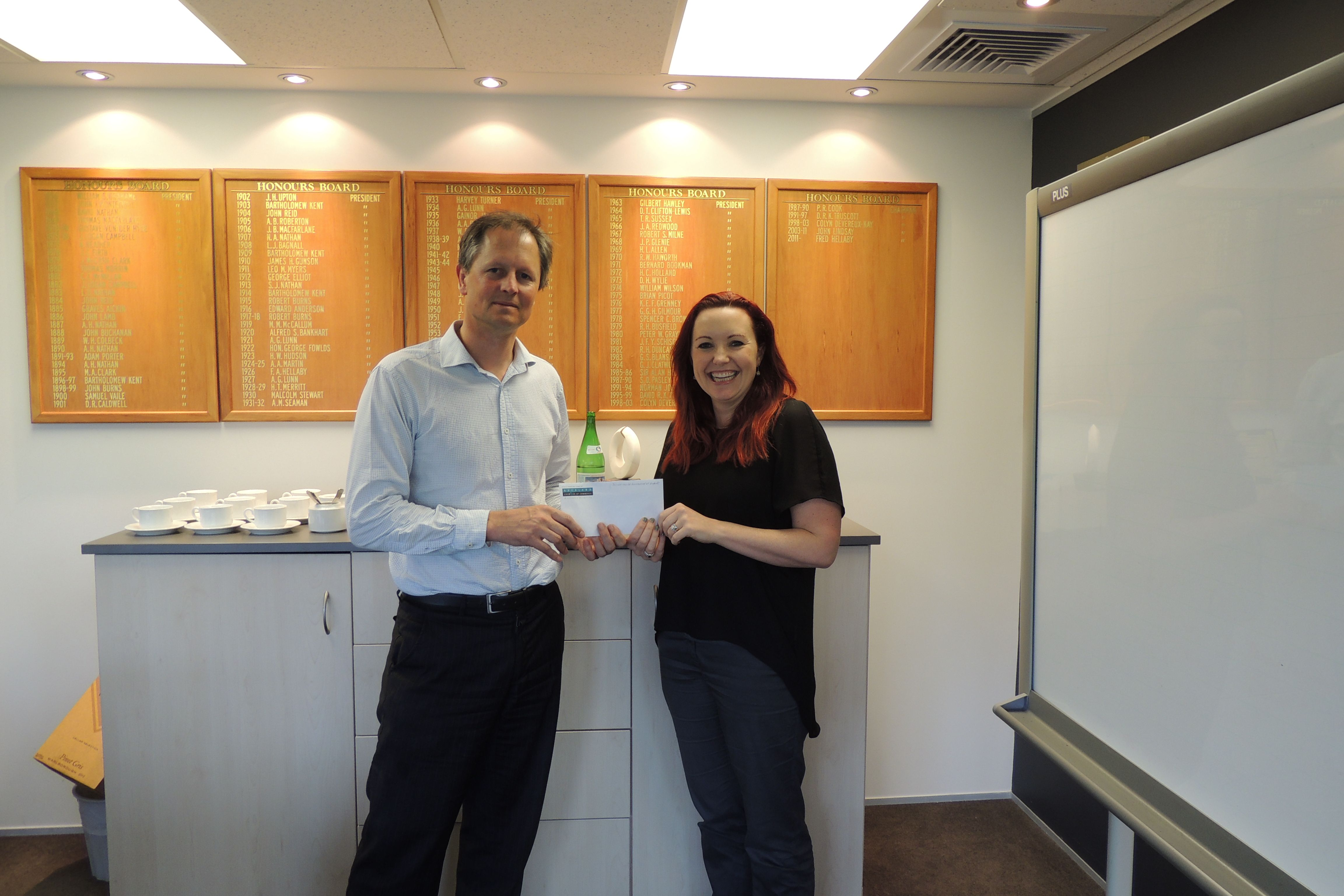 Lizzie Hines collecting her cheque for $2500 from Charles Fairbairn. Lizzie won the prize in a random draw that automatically extended to all businesses who entered the 2013 Westpac Auckland Central Business Awards;