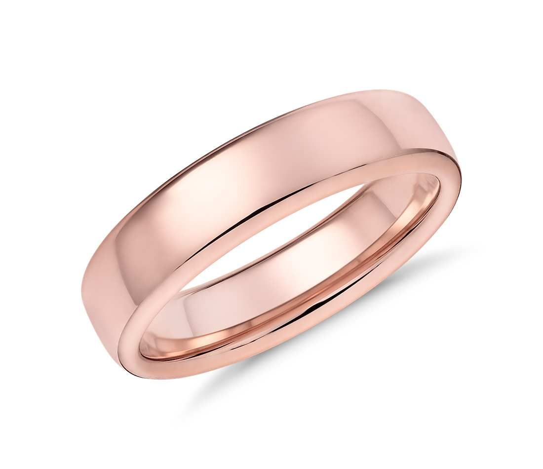 This 14k rose gold wedding band features a contemporary low dome ...