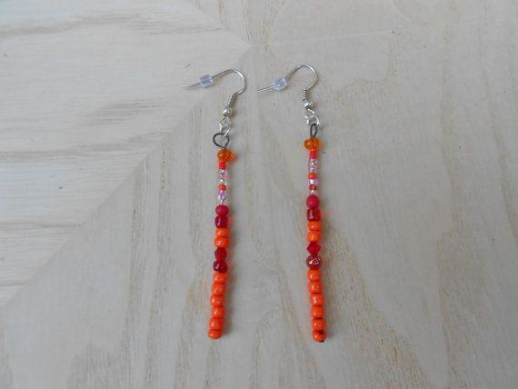 Pierced stick earrings beaded Sticks in orange by notdomesticated, $6.00