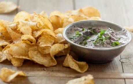 Rich and creamy, here's a lime- and cilantro-spiked creamy bean dip that pairs perfectly with our spicy, crunchy potato chips. Watch it disappear!