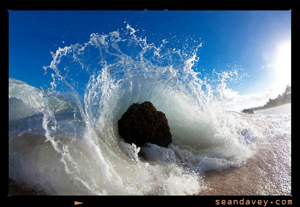 A Wave Crashing To The Beach At Log Cabin, On The North Shore Of Oahu,  Hawaii