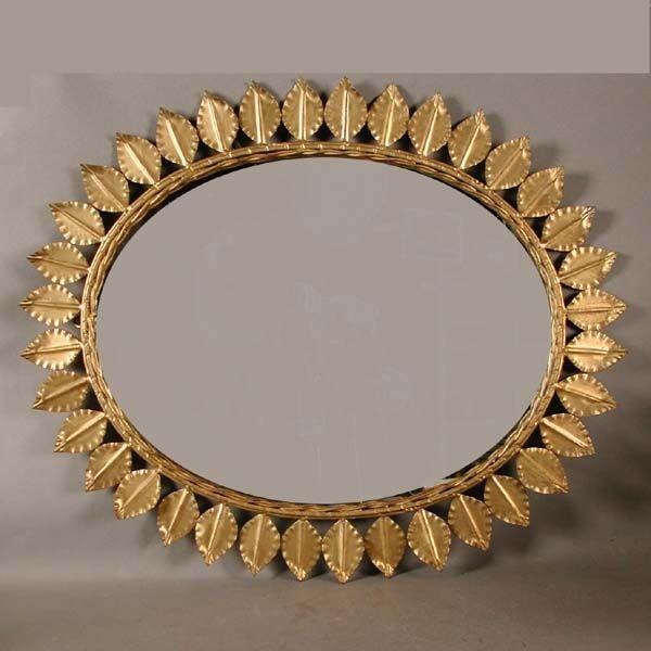 Vintage. Espejo sol vintage redondo de metal con marco de hojas ...
