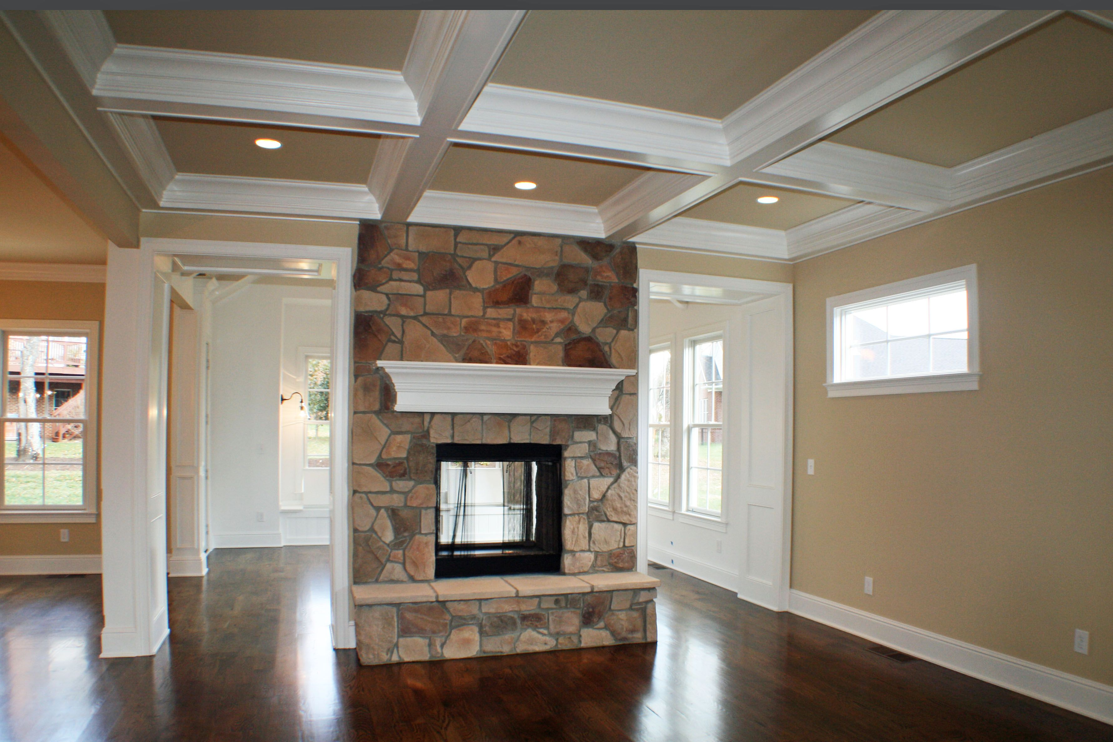 Great Room In The Custom Ann Arbor Two Sided Stone Fireplace To