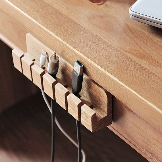 Wooden cable and charger. Organizer cable management