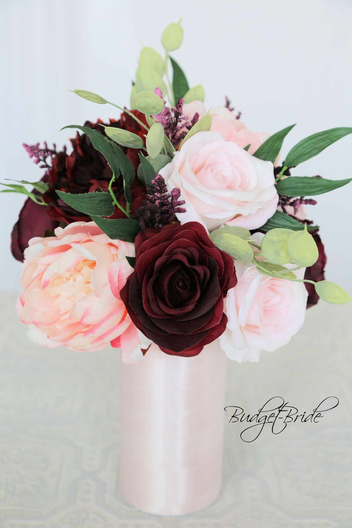 davids bridal burgundy wine and blush pink wedding flowers