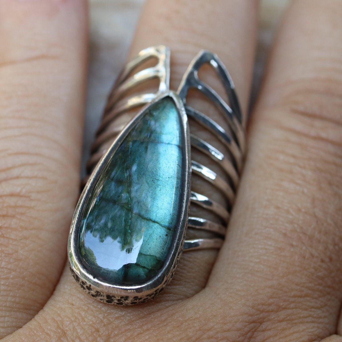 Teardrop cabochon labradorite ring in silver bezel setting with ...