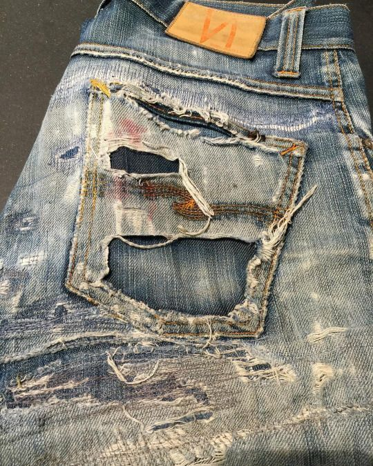 ripped pockets jeans