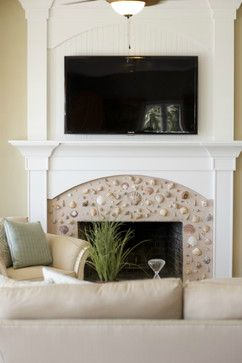 Seashell fireplace!  Used stucco. Living Room Remodel beach-style-living-room