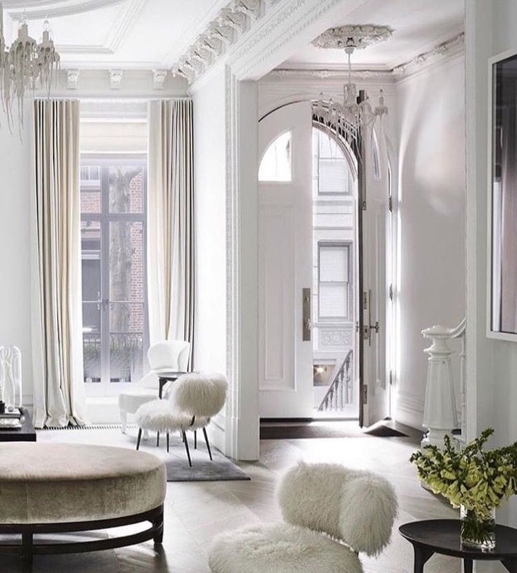 Fur chairs and a velvet ottoman add