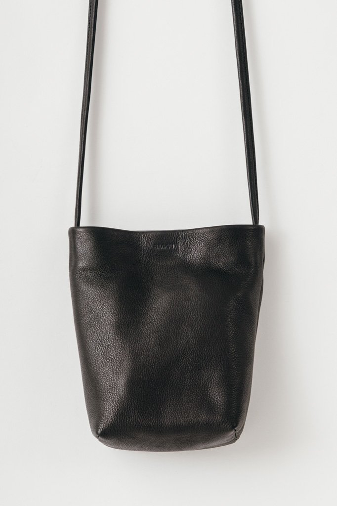 2dd187265e8 A chic and minimal cross body purse. Single magnetic top closure. Internal  patch pocket