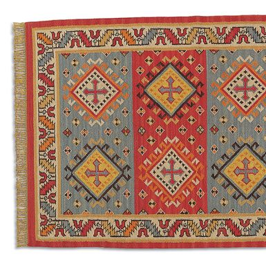 Stylized crosses give our flatweave rug a medieval air, interpreted in strong shades of red and orange, cooled by sand and gray. Handwoven with wool weft and cotton warp for added durability. Imported exclusively for Sundance. Five sizes available: 2-1/2'W x 8'L
