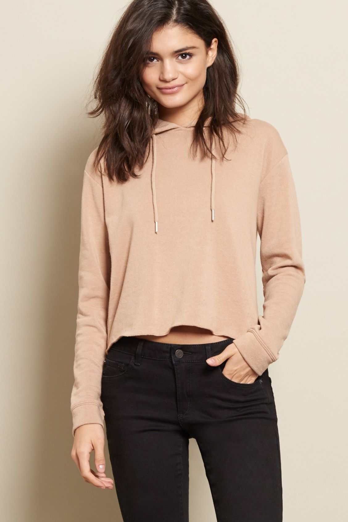 Cropped, cute, and seriously comfy. Featuring a rough hem and a ...