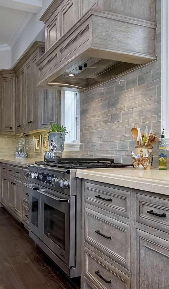 View 2 The Backsplash Of Hand Fired And Glazed Bricks Is Fabulous Stained Kitchen Cabinets Kitchen Design Kitchen Cabinets