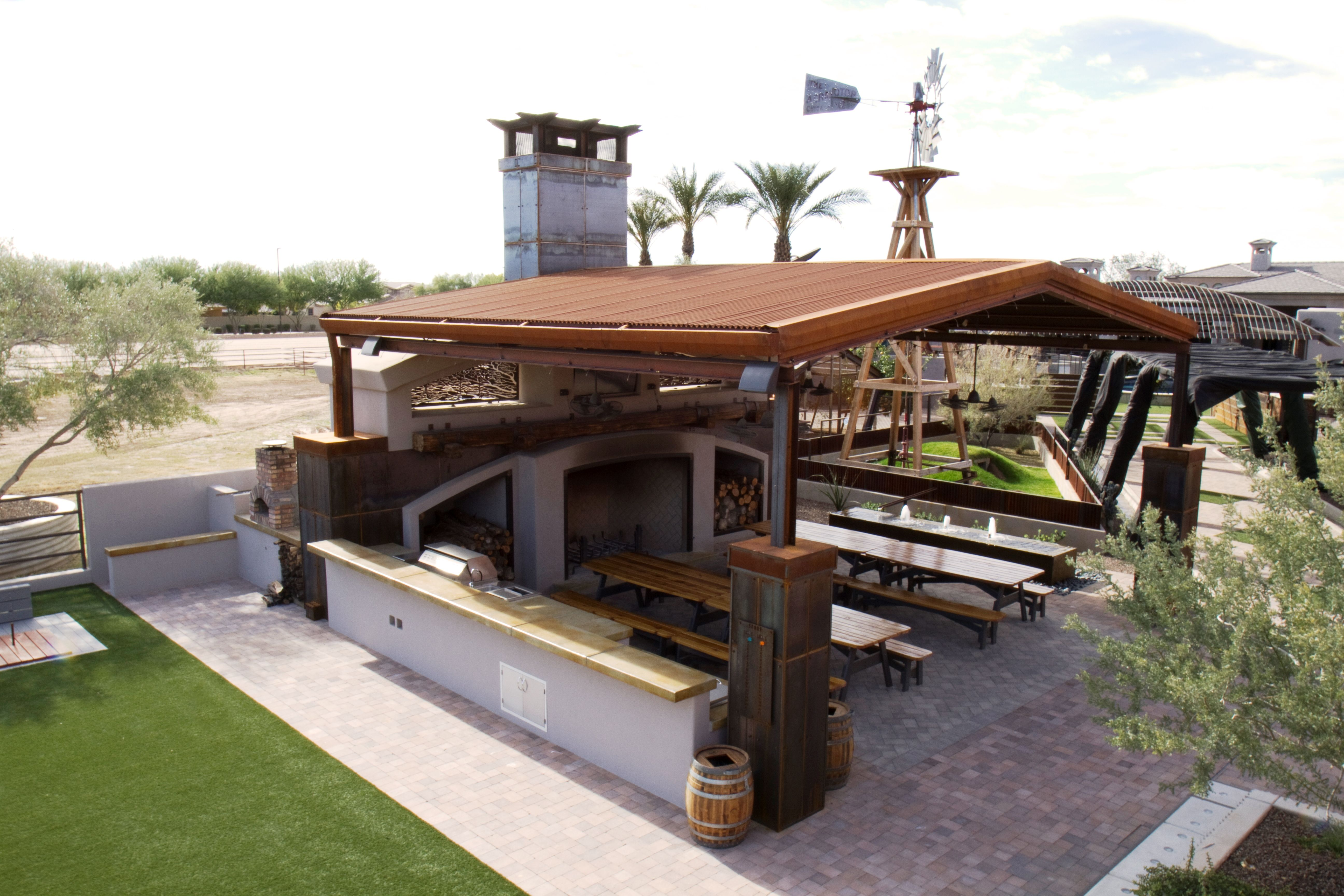 Steel shade structure over a large patio area in a luxury
