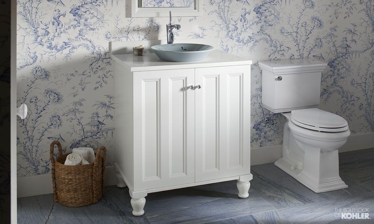 Whimsical blue and white powder room featuring Kohler Poplin vanity ...