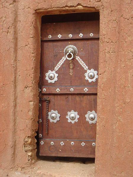 Africa | Doors and some windows. / Africa |  A decorative door in Oualata.  Mauritania |  © Kurt Dundy