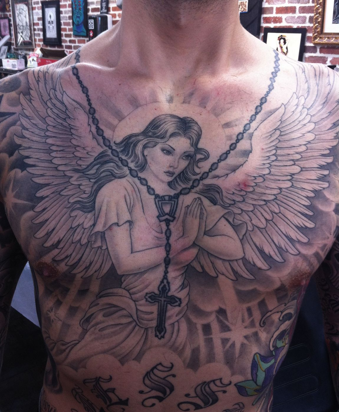 Rosary And Praying Angel Girl Tattoo On Chest Angel Tattoo Designs Cool Chest Tattoos Tattoos For Guys