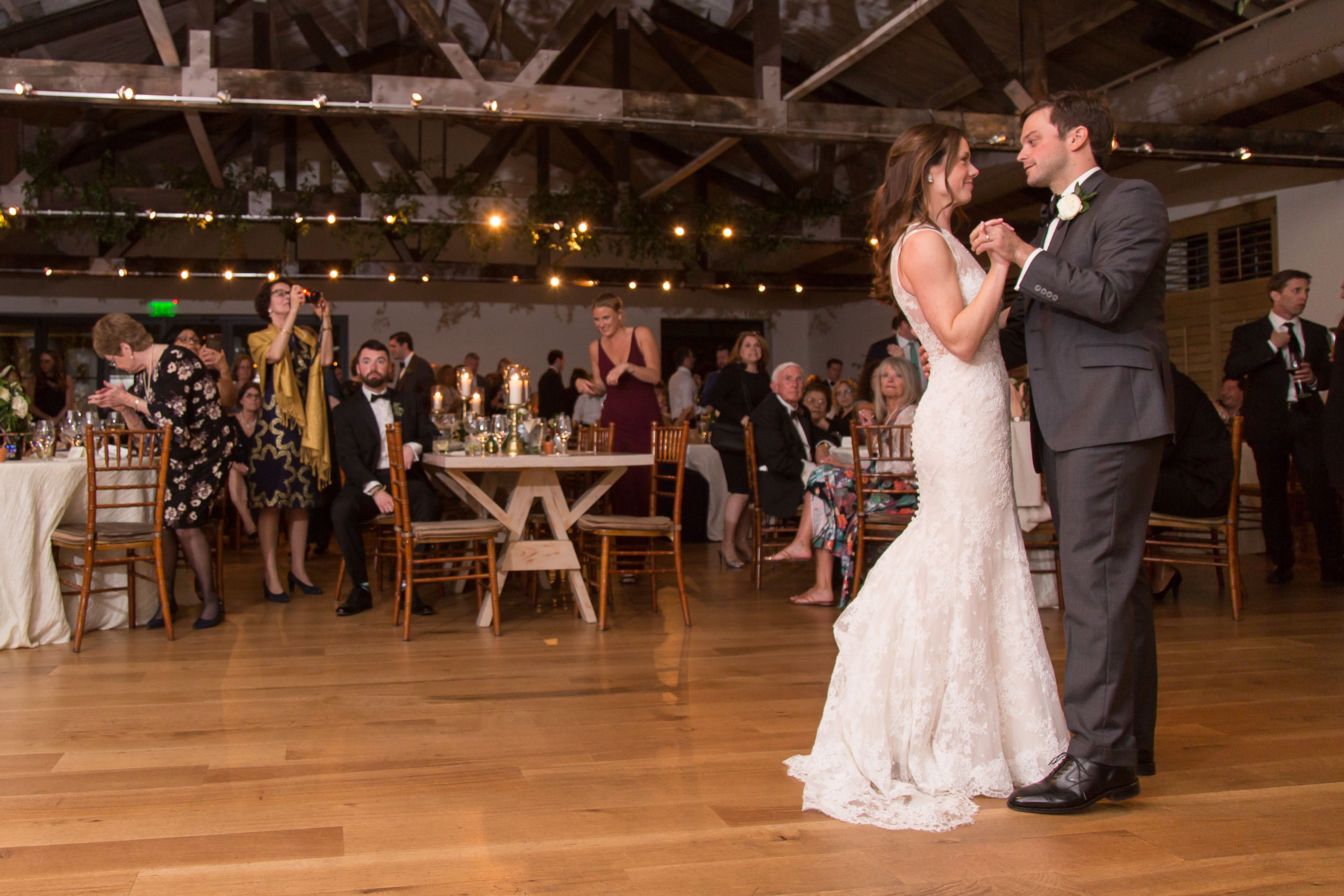 The Bride Groom Share Their First Dance Together In The Trolley Room At Cannon Green In Charleston Sc In 2020 Charleston Wedding Venues Event Venues Downtown Events