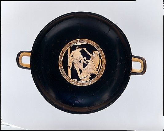 Terracotta kylix (drinking cup)  Attributed to the Briseis Painter     Period:      Classical  Date:      ca. 480 B.C.  Culture:      Greek, Attic  Medium:      Terracotta  Dimensions:      H. 5 3/16 in. (13.2 cm) width with handles 15 3/8 (39.1 cm) diameter 12 1/16 in. (30.7 cm)  Classification:      Vases