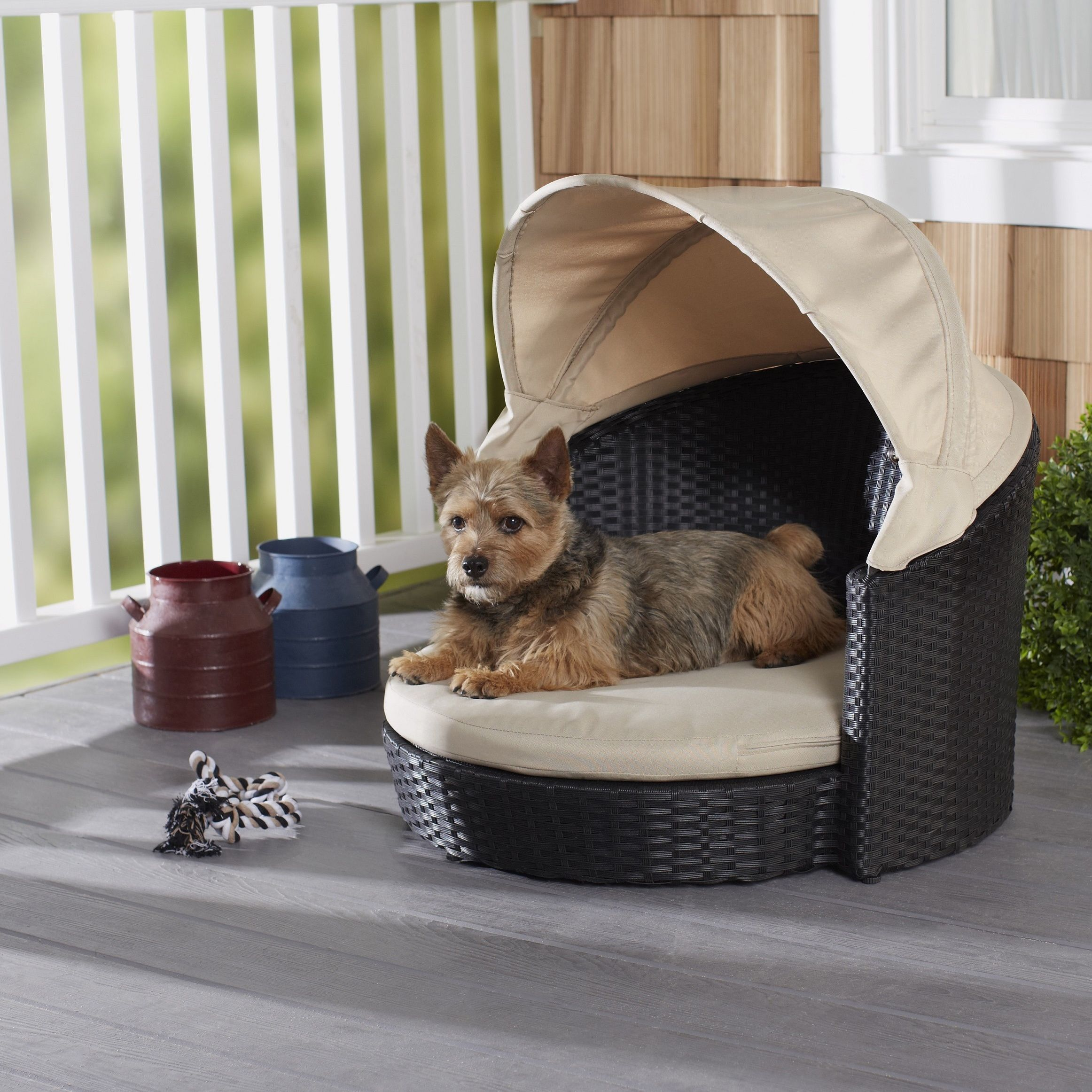 Indoor/ outdoor furniture-style rattan pet bed features a comfy ...