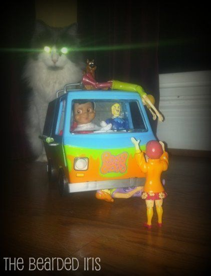 The Elf on The Shelf, posed with Scooby and The Gang (and my cat) by @TheBeardedIris, 2011.