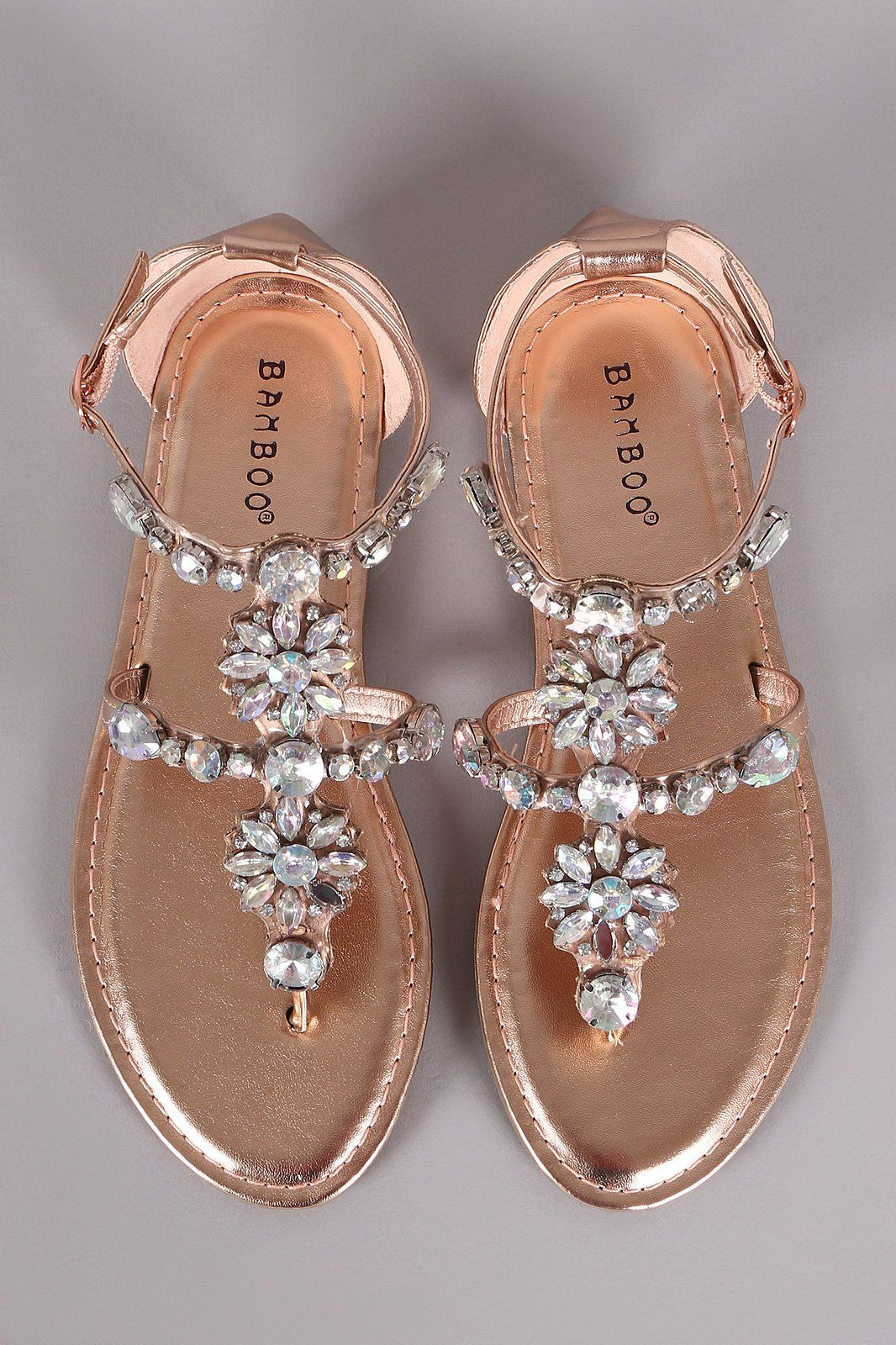 f8a8048a8f3 This cute flat sandal features rhinestone embellished T-strap design ...