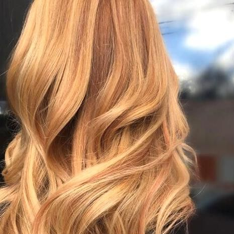 long strawberry blonde hair with curls