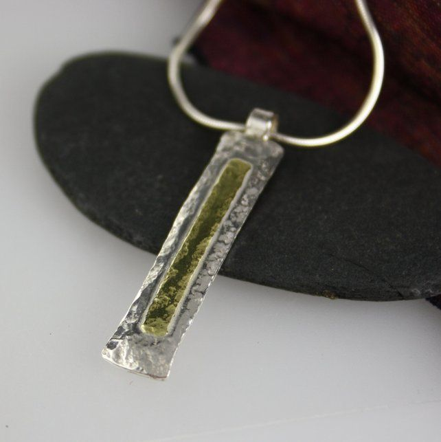Silver and 18 ct gold pendant and chain £74.00