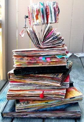 Orly Avineri's pile of journals - love the fact they look like they want to explode with vibrant creativity!