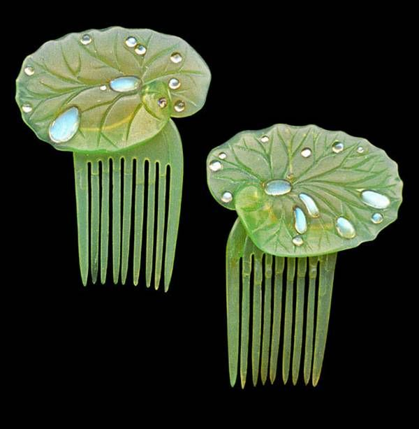 Her Lalique waterlily hair combs float in the sea of her waving golden hair